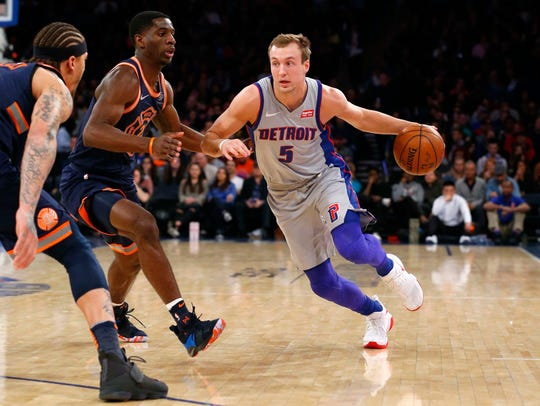 Pistons guard Luke Kennard drives to the basket against