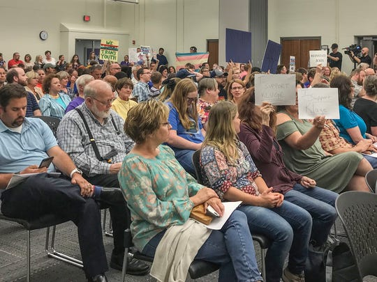 Supporters of embattled teacher John Kluge and those