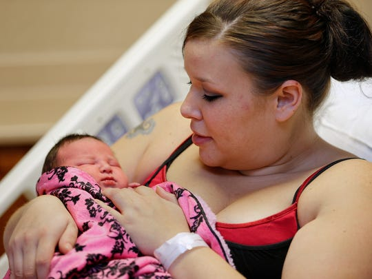 Brianne Kramer holds her newborn baby, Kynncia, on Friday. Kynncia is the first baby born at Benefis Health System this year.