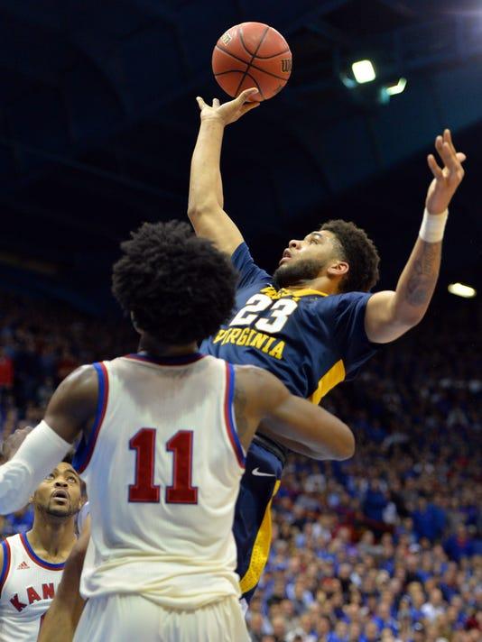 USP NCAA BASKETBALL: WEST VIRGINIA AT KANSAS S BKC USA KS