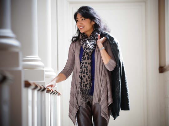 Pianist Hiroko Yamazaki wears brown Gap leather pants, a purple silk/cotton/cashmere DKNY tank top and a metallic INC draped cardigan with a black leather jacket by Avanti.