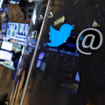 The logo for Twitter adorns a phone post on the floor