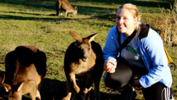 Keeley in Australia visiting with kangaroos. (Courtesy of Meredith Keeley