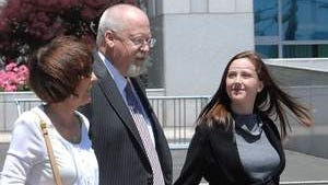 Harvey Whittemore with his family leaves federal court Wednesday May 29 after being found guilty of three of the four charges against him.