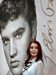 "Priscilla Presley glances at a crowd of fans after a dedication ceremony on Aug. 12, 2015, for the Elvis Forever stamp. She will be back at Graceland Sept. 27-29 to host the ""Elegant Southern Style Weekend."""