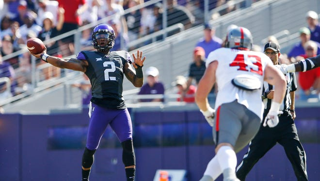 TCU quarterback Trevone Boykin (2) throws a pass in the Horned Frogs' 82-27 win Saturday over the Texas Tech Red Raiders. Boykin threw for 433 yards and seven touchdowns.