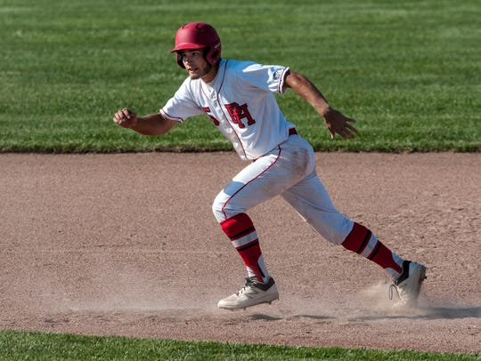Port Huron's Curtis Corby runs for second during a
