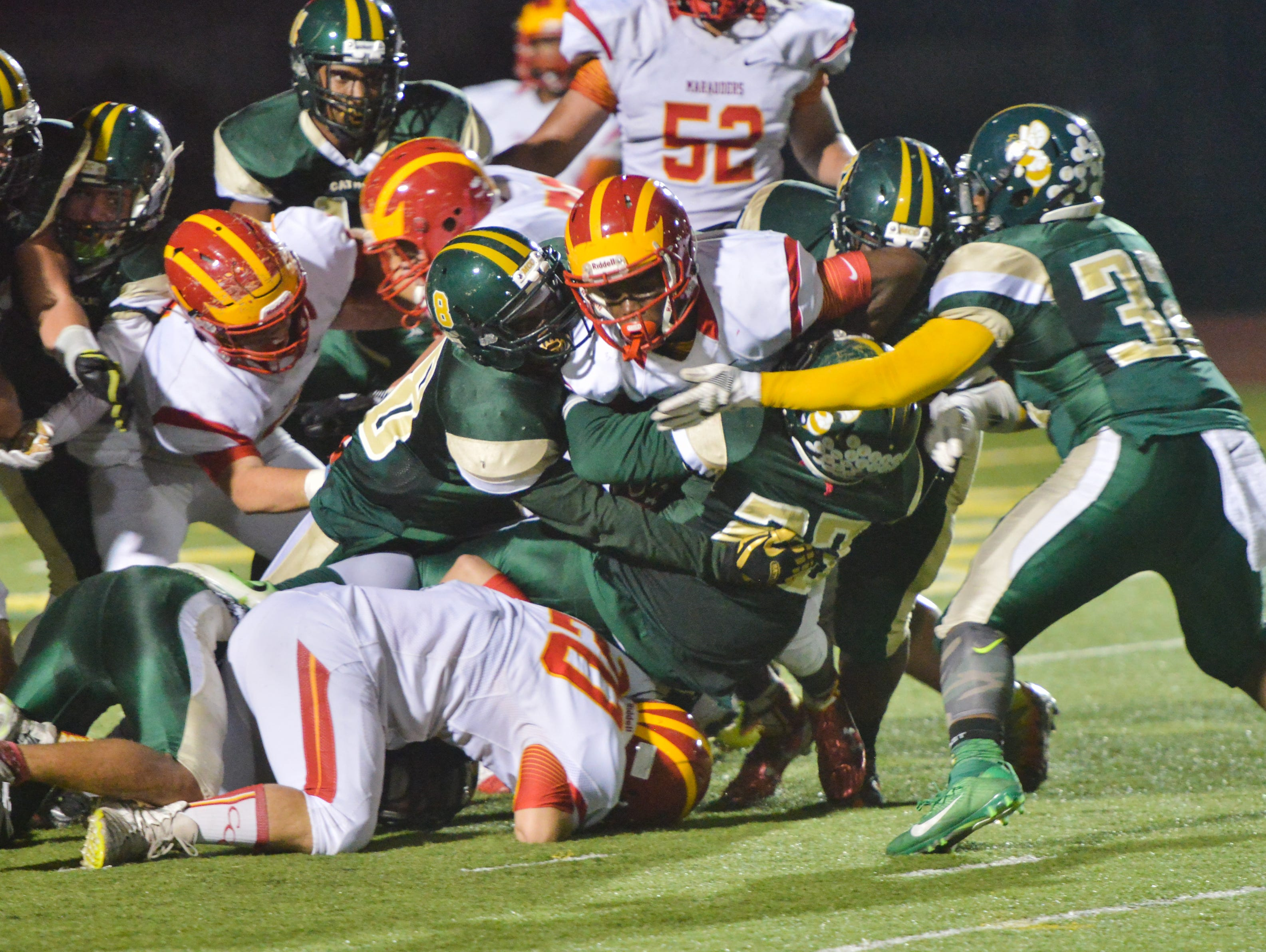 The Melbourne Central Catholic defense stops Clearwater Central Catholic from scoring on a fourth down during the second quarter.