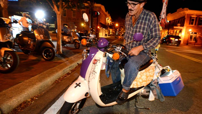 George Pope pulls up to Al Fresco on Palafox Street to join other scooter enthusiast for a Scoot Pensacola meet-up.