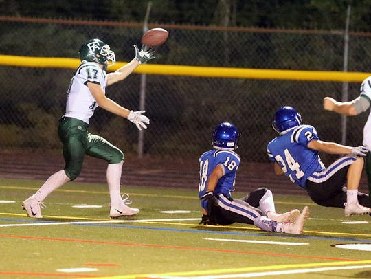 Port Angeles receiver Garrett Edwards makes a one-handed