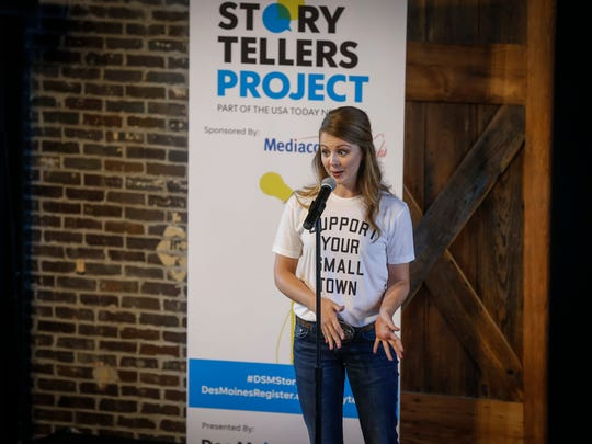 Lexi Marek talks about raising pigs as a young girl during the Des Moines Storytellers Project at the River Center on Thursday, July 12, 2018, in Des Moines.