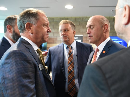 Reinhold Schmieding, left, founder and president of Arthrex, meets Clemson University President Jim Clements at the Civic Center of Anderson in South Carolina on Monday during an announcement of Arthrex's expansion plans.