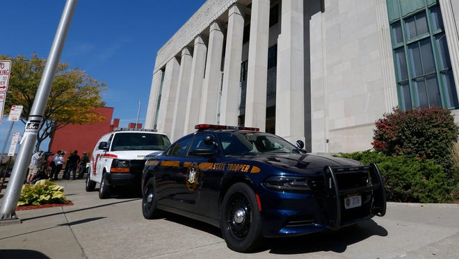 New York State Police and Broome County Sheriff vehicles outside federal court in Binghamton on September 20, 2017.