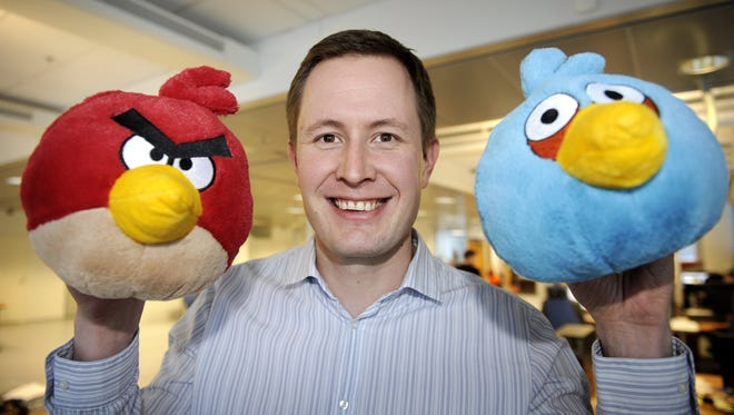 Rovio CEO Mikael Hed poses with two Angry Bird characters at the company's headquarters in Espoo, Finland in 2011.