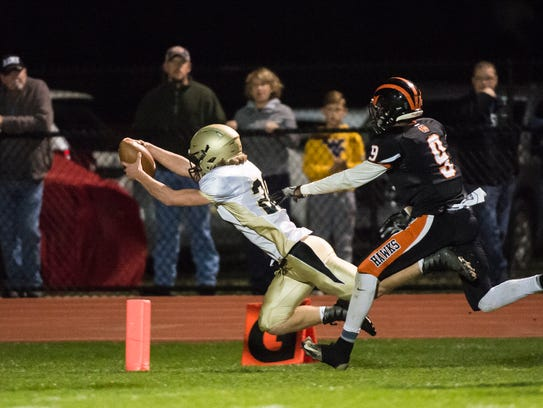 Delone Catholic's Ryan Hart dives into the end zone