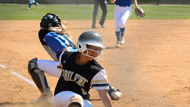 Abilene High's K'Ci Walker slides into the plate ahead of the throw during the Lady Eagles' 14-0 win over Weatherford on Tuesday at the AHS softball field.