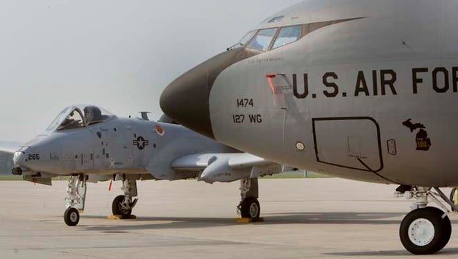 An A-10 Thunderbolt II attach aircraft  (left) and a KC-135 Stratotanker air refueling aircraft were on display for seven Michigan members of Congress who were visiting Selfridge Air National Gurad Base in Harrison Twp. in Michigan on Wednesday, Sept. 2, 2015.