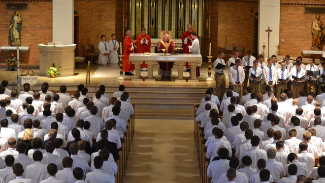 Bishop Roger J. Foys celebrates the Eucharist with students of Covington Catholic at an opening school year Mass.