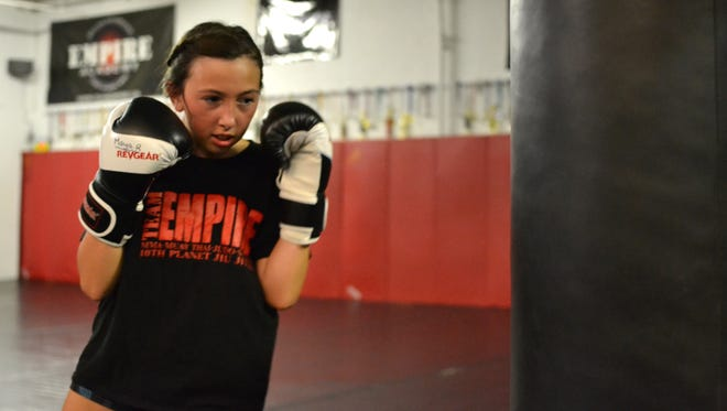 Maya Rossi, 11 of Fairport practices MMA at Empire Academy of Combat Sports and Fitness.