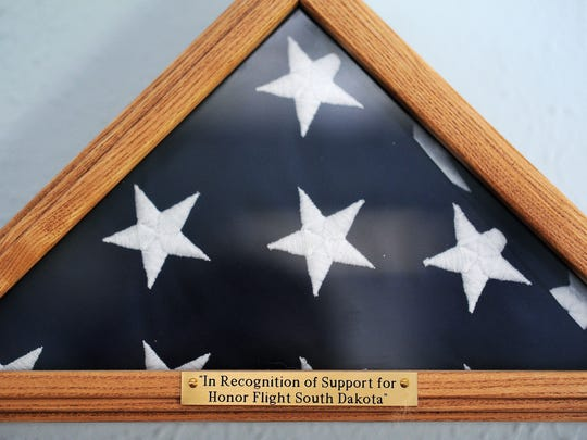 Ken Salisbury received an American flag in recognition of his support of Honor Flights.