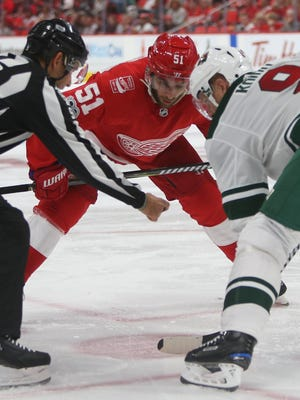 Red Wings' Frans Nielsen faces off against the Minnesota Wild's Mikko Koivu in the third period at Little Caesars Arena in Detroit, Thursday, Oct. 5, 2017.