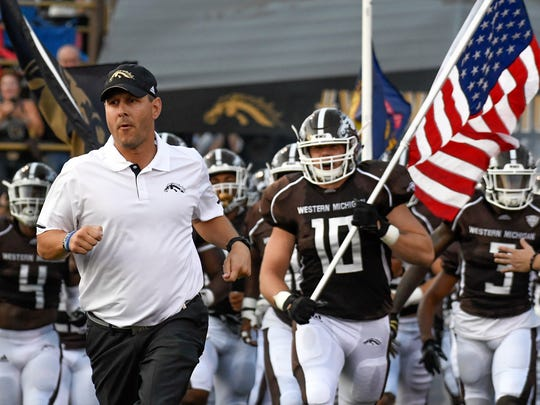 Western Michigan head coach Tim Lester leads the Broncos onto the field at Waldo Stadium on September 16, 2017.