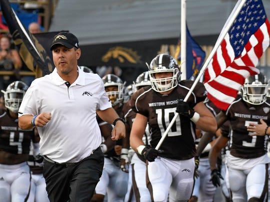 Western Michigan head coach Tim Lester leads the Broncos