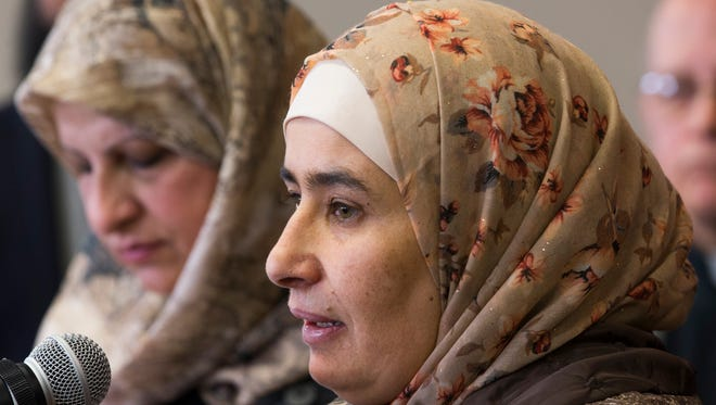 Smaher Aldaye, a Syrian refugee who arrived in the U.S. 10 days ago, speaks at a news conference in Greenfield.