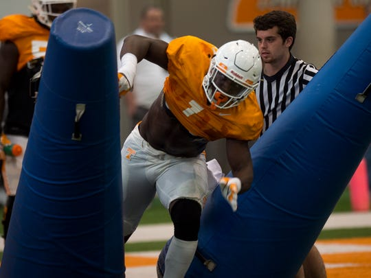 Tennessee's Jonathan Kongbo (1) participates in a drill during football practice on Thursday, April 6, 2017.