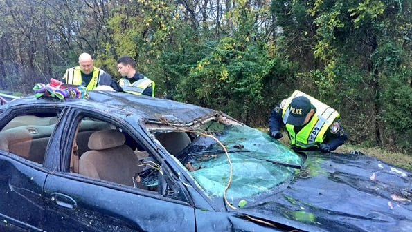 Mt. Juliet Police investigate a car that rolled over off I-40 near the Wilson-Davidson county line Monday, Nov. 9, 2015