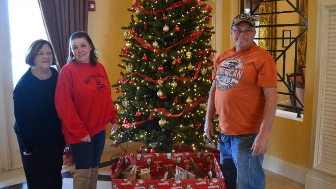 David and Kelly Long from Angels of Hope recently picked up a variety of non-perishable food items that were donated by residents at St. Andrews Park Villas. Cathy Prisco, left, sales manager at St. Andrews Park Villas, with Kelly and David Long.