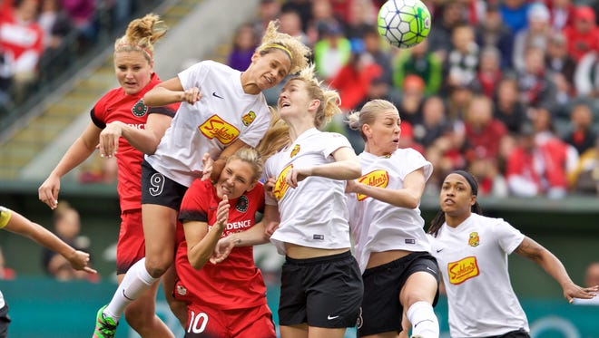 WNY's Lynn Williams (9) and Sam Mewis (also in white) sky over Portland's Allie Long during last week's NWSL semifinal upset at No. 1 Portland. Williams, the NWSL's top scorer with 13 goals, was named league MVP on Thursday.