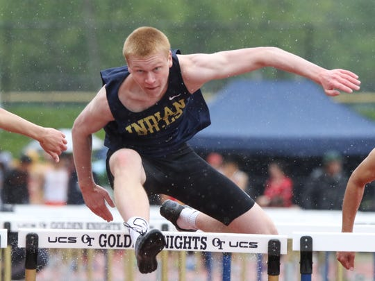 Hank Anderson of Indian Hills wins the Boys 110 meter hurdles in the A division.