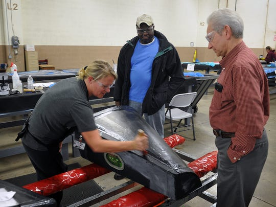 In this 2016 file photo, Amfuel CEO Len Annaloro, right, talks with Aleisha Tweed and Carl Harris as they seal the seams on a fuel cell for a Robinson helicopter. Annaloro joined the company in November 2016, with big plans to expand the business. The company announced in December 2017 they are declaring Chapter 11 bankruptcy and closing the Wichita Falls site.
