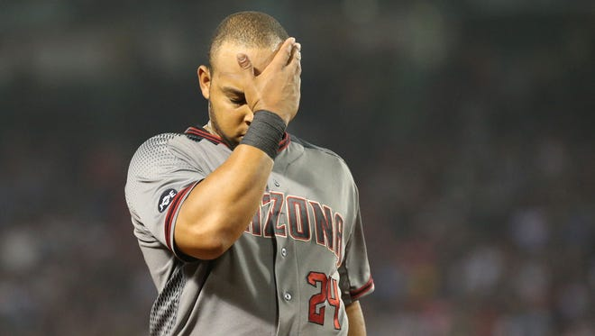 Aug 13, 2016; Boston, MA, USA; Arizona Diamondbacks left fielder Yasmany Tomas (24) reacts after the top of the sixth inning of a game against the Boston Red Sox at Fenway Park.