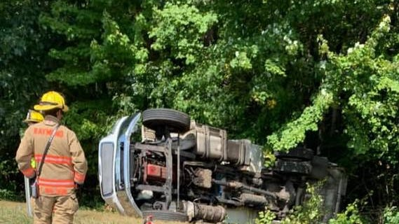 Police are investigating a garbage truck rollover on Route 101 Tuesday afternoon that injured both the driver and passenger.