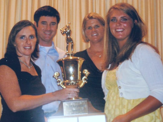 Bubba Watson with three of past female champions of the Divot Derby, including multiple, former champions Robin Dezarn (left) and Kristen Dorsey (far right) during a 2012 banquet honoring the history of the event.