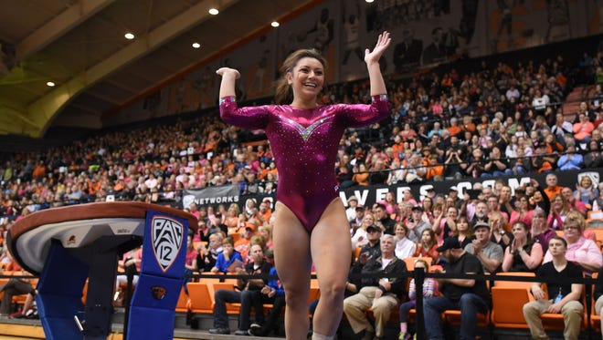 Oregon State's Erika Aufiero waves to the crowd after competing in the vault during a meet against Arizona on Saturday, Feb. 7, 2015, in Corvallis.