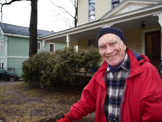 """A living link to the Green Mountain Parkway is longtime Green Mountain Club stalwart Clem Holden. He is seen recently in front of his former family home on South Union Street, Burlington. Holden remembers when the engineers for the Parkway stayed there as boarders in 1934. Holden says, """"the Parkway would not have been built on the mountaintops."""""""
