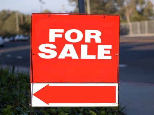 "Red ""for sale"" sign with white letters and a red arrow pointing left"