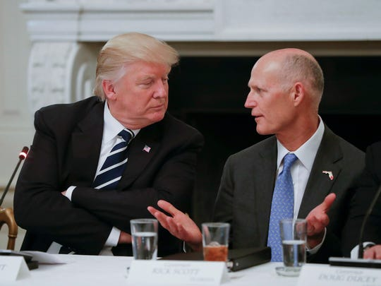 President Donald Trump listens to Florida Gov. Rick Scott, right, during a meeting with U.S. mayors and governors for an Infrastructure Summit in the State Dining Room of the White House in Washington on Thursday, June 8, 2017.