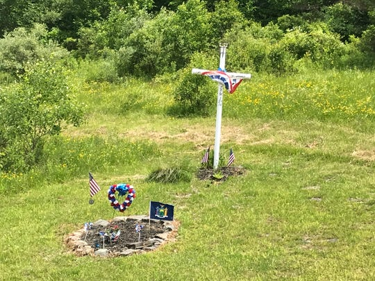 A memorial on Interstate 81 North in the Town of Chenango for New York State Trooper Christopher Skinner.