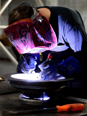 Jeff Kropp welds waste water treatment components during work at 5 Point Fabricating.