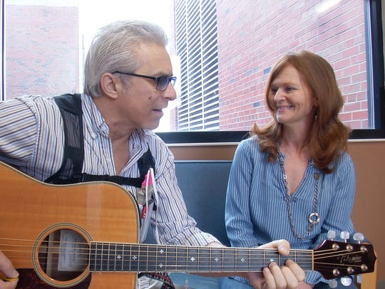 Loren Vinal of Corning plays guitar for his life partner,