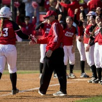 UL head coach Michael Lotief shakes hands with catcher Lexie Elkins (33) after she hit a home run during a softball game Feb. 13, 2015, against Idaho State in the Mardi Gras Classic Tournament at Lamson Park.