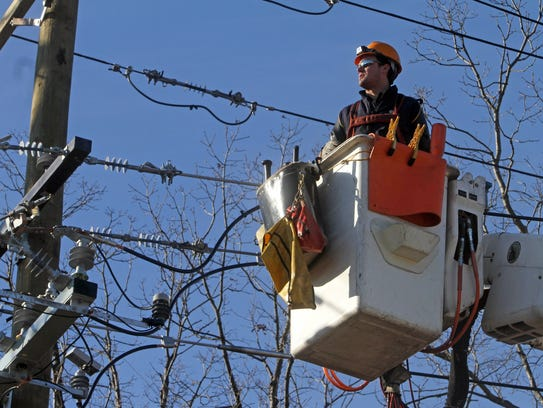 An Orange and Rockland worker in a 2012 file photo.