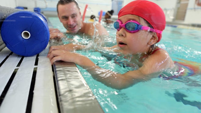Aiva Reid, 7, of Nanuet, gets a swimming lesson that stresses water safety from Matt Williams, assistant aquatics director at the Rockland County YMCA in Nyack June 18, 2015.