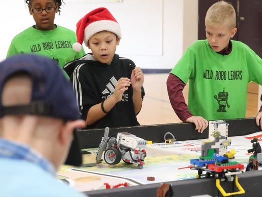 Tyler McCoy, 10, and Bryan Kirilinas, 10, react to