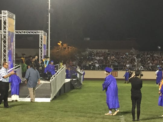 Mariam Cheshire walks to the stage to receive her diploma