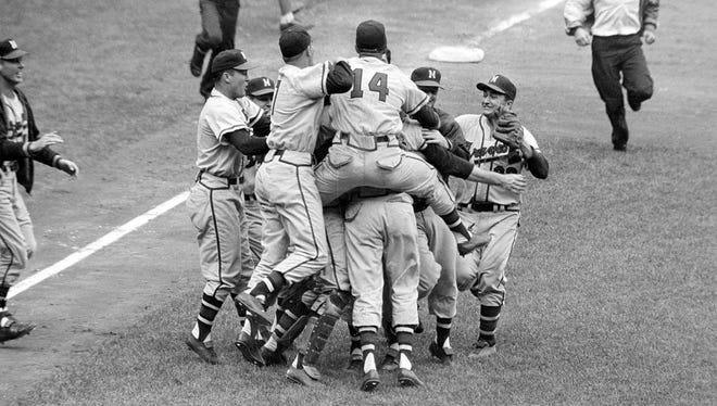 The Milwaukee Braves celebrate their 5-0 victory over the New York Yankees in Game 7 of the 1957 World Series in New York.